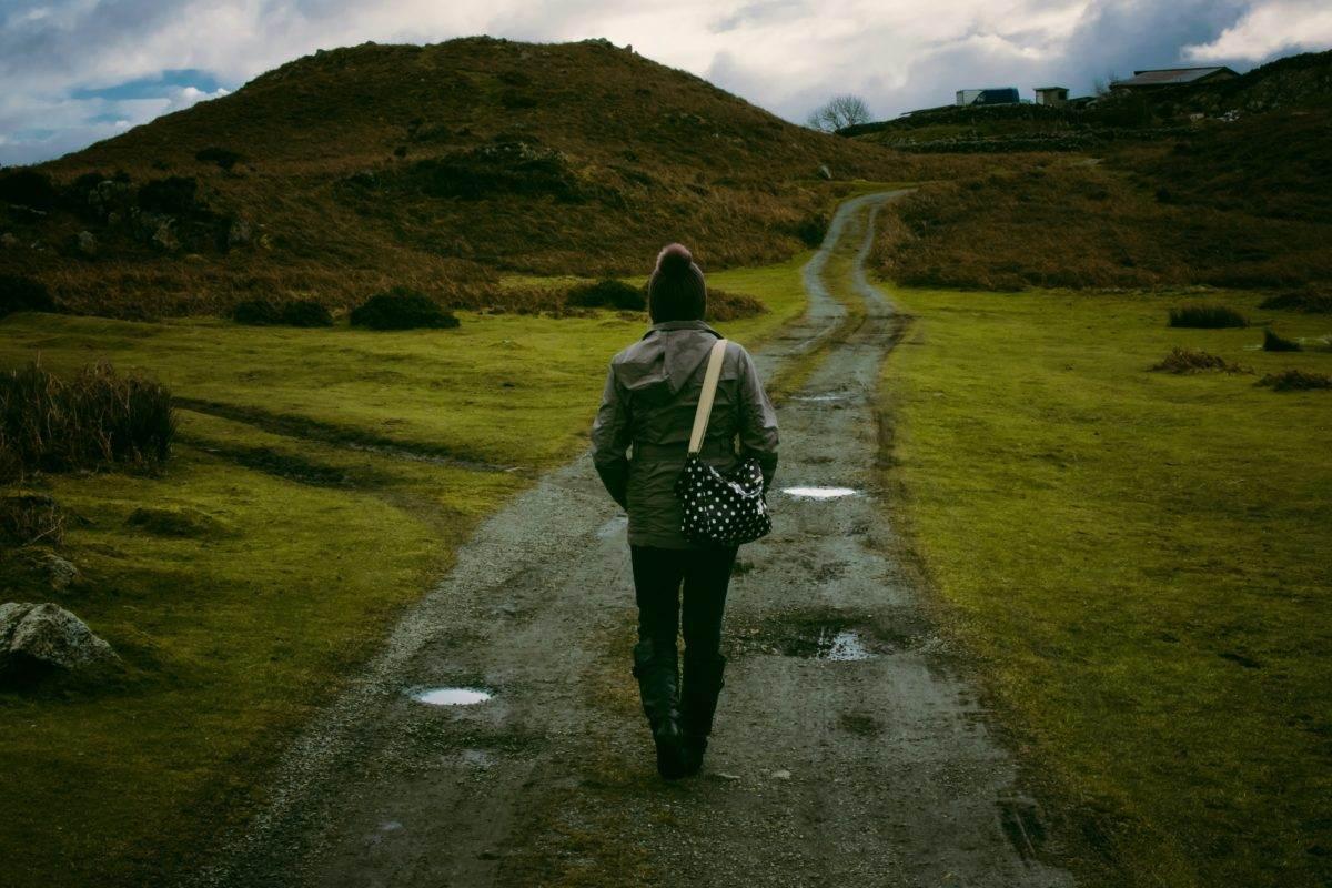 woman walking down path