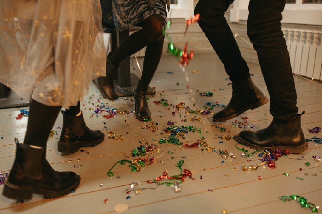 Three people dancing in confetti