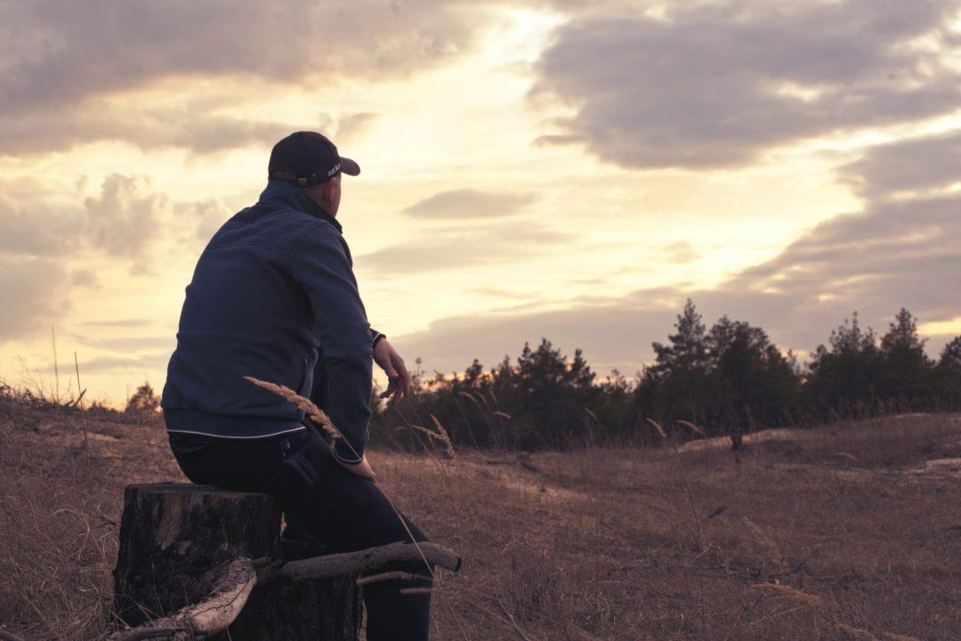 man looking at woods