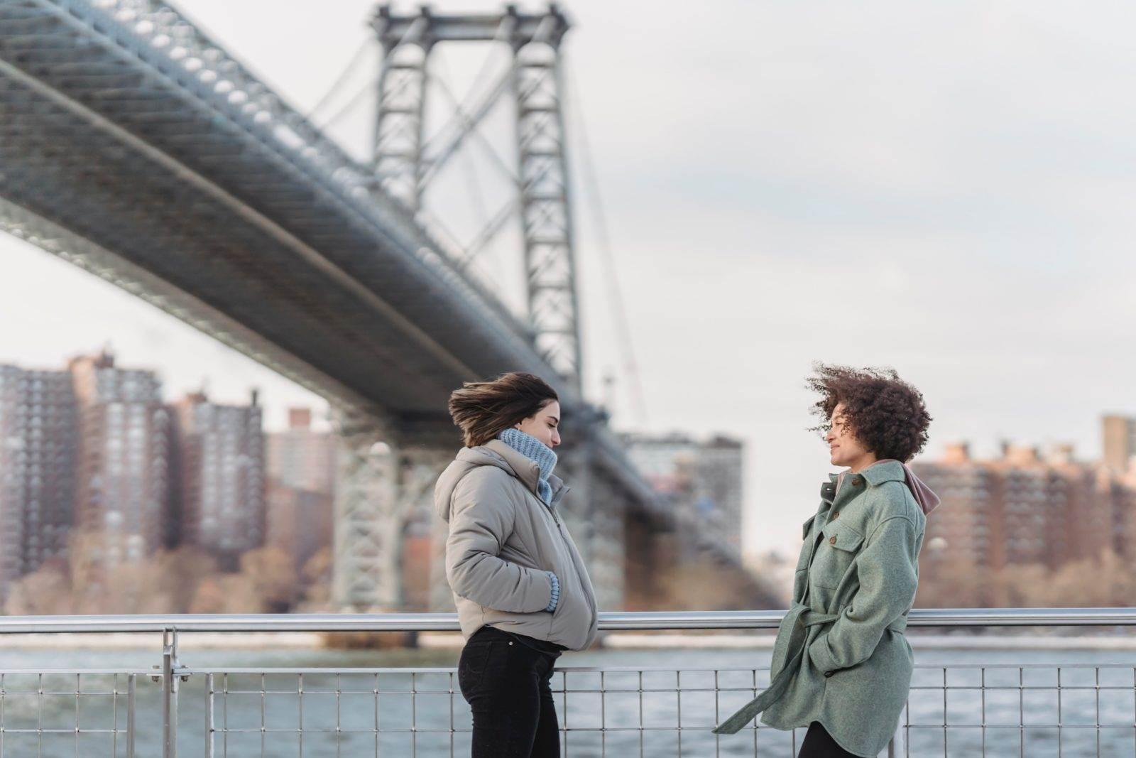 women by a bridge