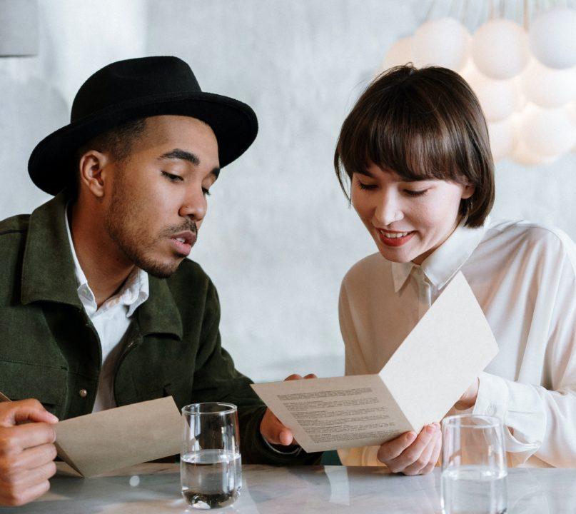 people looking at a menu
