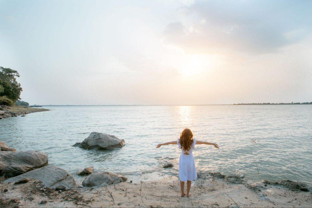 Woman on beach at sunset