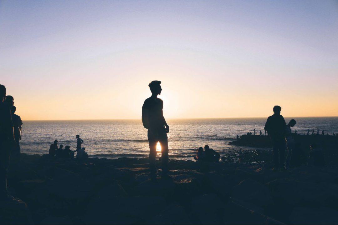Man at beach at sunset