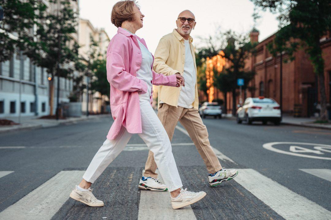 Elderly couple crossing the street
